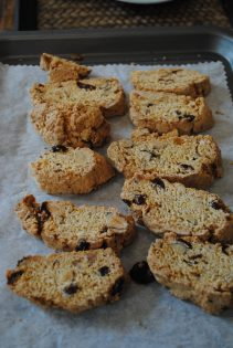 Slices of Cobnut and cranberry biscotti on baking tray