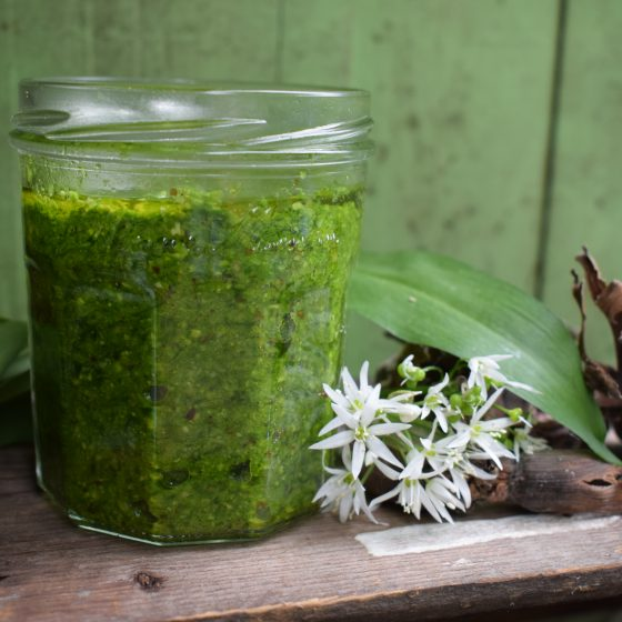 Wild garlic and cobnut pesto on wooden table