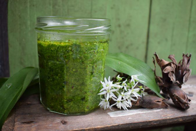 Wild garlic and cobnut pesto on wooden table
