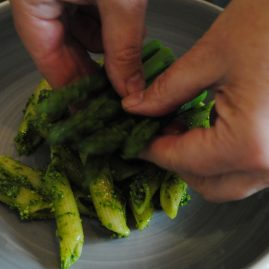 Placing asparagus on cobnut pesto