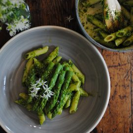 Cobnut pesto and pasta recipe on wooden table