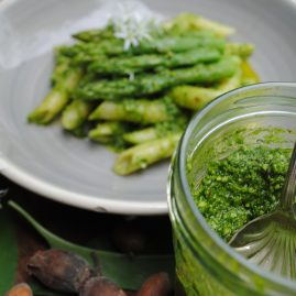 Jar of cobnut pesto and pasta dish with husked cobnuts
