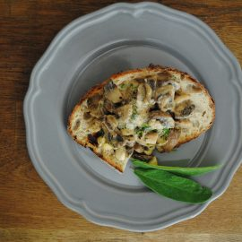 From above plate of sour dough toast, creamed mushrooms and cobnuts