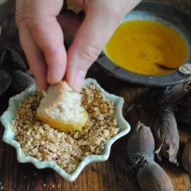 Dipping bread in cobnut dukkah