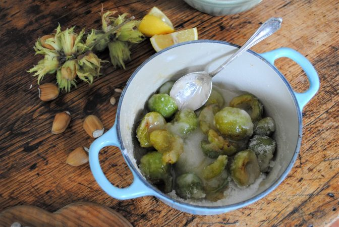 Making Greengage and cobnut jam with lemon and sugar