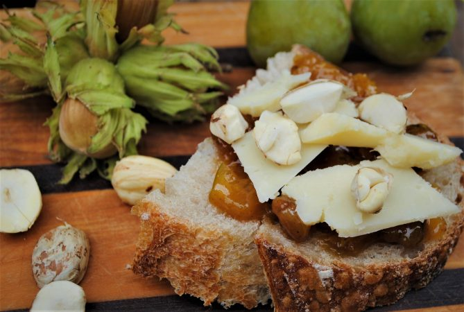 Slice of sourdough, cheese, cobnut and greengage chutney