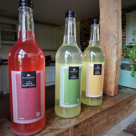 Fresh Apple Juices from Roughway Farm on wooden side of kitchen